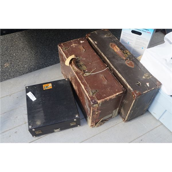 2 vintage leather cases with vintage projector