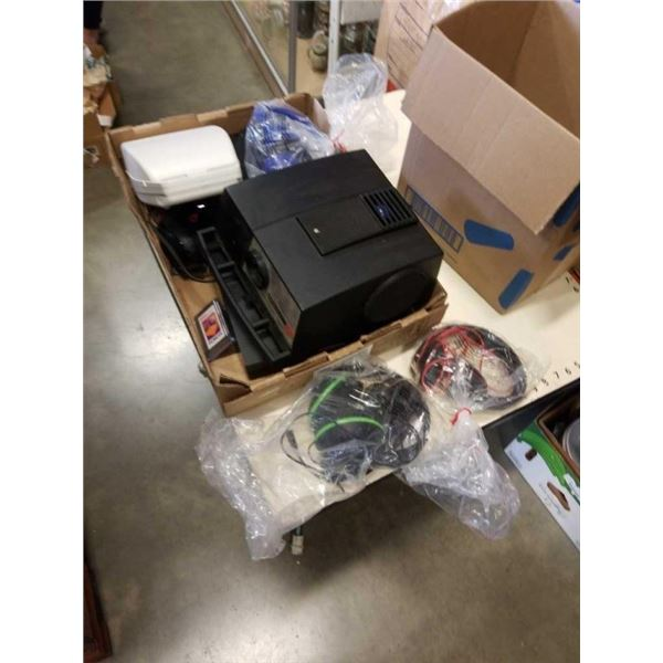 2 BOXES OF HEADPHONES, PS3 CONSOLE, PROJECTOOR AND MORE