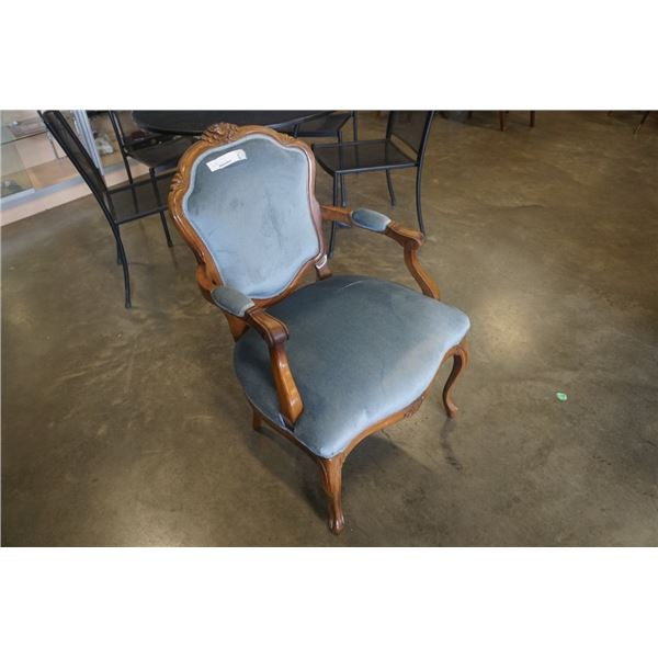 Carved French provincial arm chair