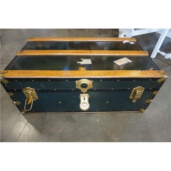 Vintage green steamer trunk