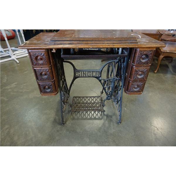 Vintage singer sewing machine in trestle table