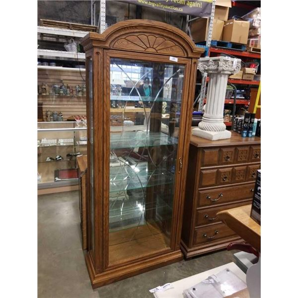 BUHLER GLASS AND OAK DISPLAY CASE - OVER 6 FOOT TALL