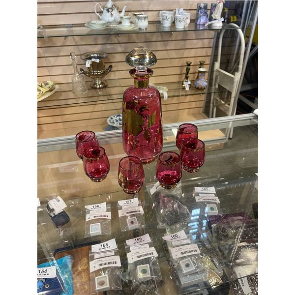 Cranberry glass decanter with 6 glasses