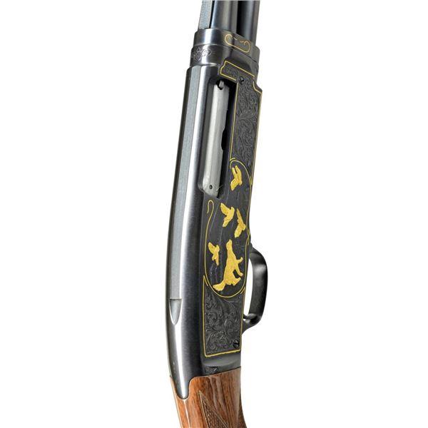WINCHESTER MODEL 42 CUSTOM ENGRAVED PUMP SHOTGUN.