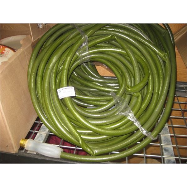 PAIR OF USED GREEN GARDEN HOSES