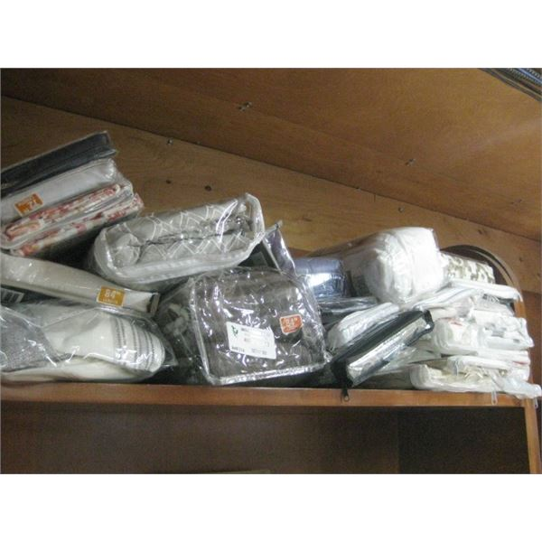 SHELF OF ASSORTED PANEL CURTAINS