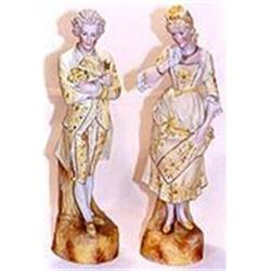 Yellow Bisque statues of a lady and a gentleman#2393682