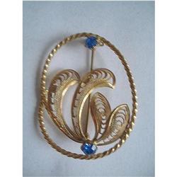 Art Deco Filigree Brooch of Blue Rhinestones & #2376091