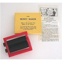 VINTAGE ADAMS MAGIC MONEY MAKER TOY #2377062