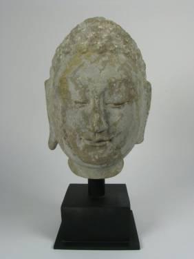 A FINE NORTHERN QI LIMESTONE HEAD OF BUDDHA,