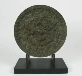 A SUPERB TANG DYNASTY BRONZE MIRROR, c.618-90