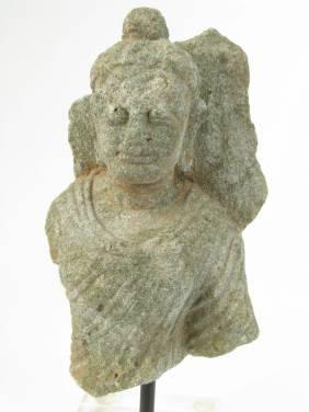 A RARE GANDHARAN SCHIST TORSO OF BUDDHA, 2nd-