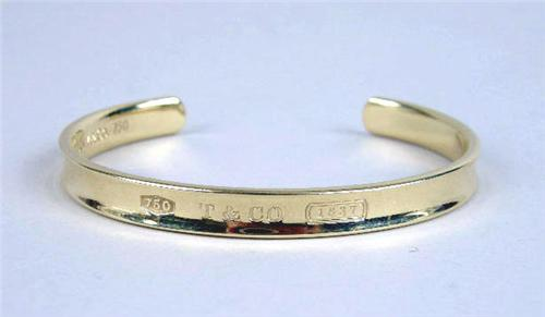 0048ceee1 Image 1 : A TIFFANY AND CO. 18K YELLOW GOLD OPEN BANGLE BRACELET ...