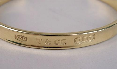2c64a0b55 ... Image 2 : A TIFFANY AND CO. 18K YELLOW GOLD OPEN BANGLE BRACELET ...