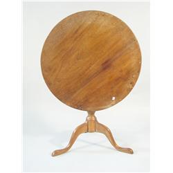 An American walnut tilt-top tea table.