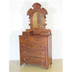 A Victorian carved walnut mirrored dresser.