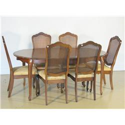 A 20th Century French Provincial style dining table with six