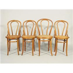 A set of four Bentwood and caned side chairs.