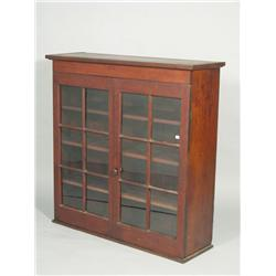 A 19th Century American walnut cabinet lacking base.