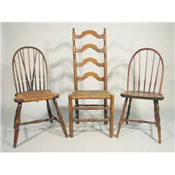 Two 20th Century Windsor style chairs, together with a third
