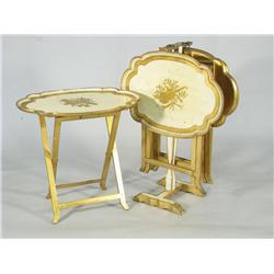 Four Louis XV style folding tray tables with stand.