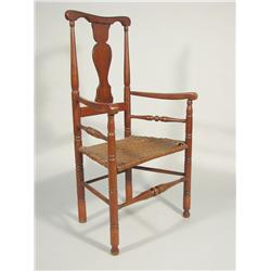 A 19th Century American walnut armchair with caned seat.