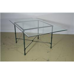 A Contemporary glass and wrought iron table.
