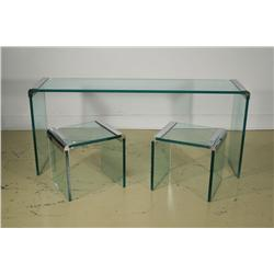 A group of three mid-century modern chrome and glass tables,