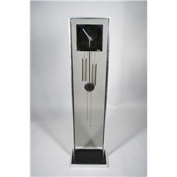 A Howard Miller style chrome and plexiglass clock,