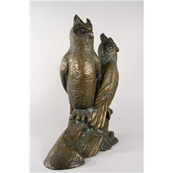 A Sculpture of two owls marked SC,