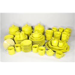 Italian earthenware yellow glaze dinner service for twelve.