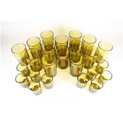A set of twelve large yellow blown glasses together with ten