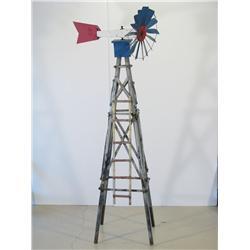 An American Folk Art metal sculpture of a Windmill, Artist U