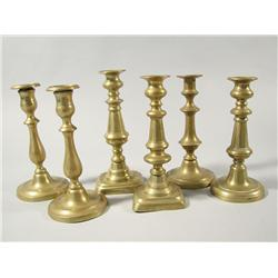 A group of six 19th and 20th Century brass candlesticks, thr