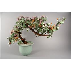 An Oriental glass and metal bonsai tree in ceramic pot.