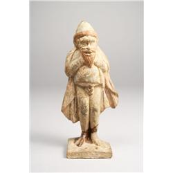 A terracotta figure of a man.