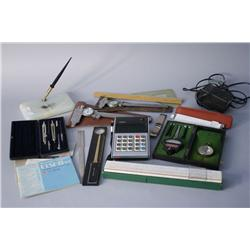 A collection of miscellaneous drafting instruments and ruler