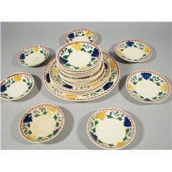 A collection of Stick Spatter plates and saucers,
