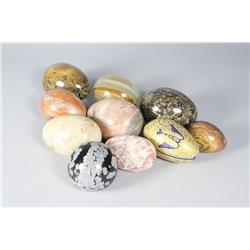 A collection of eight egg form marble specimens,