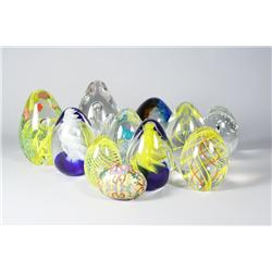 A collection of eleven glass egg forms.