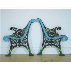 Two 19th Century cast iron bench frames with painted decorat