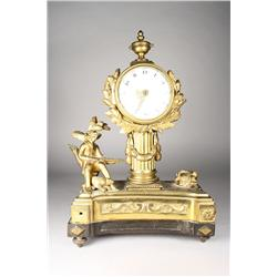 A Louis-Philippe gilt bronze mantel clock.