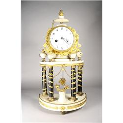 A Louis XVI gilt bronze mounted marble mantel clock.