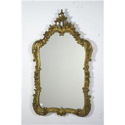 A Louis XV Style gilt framed mirror.