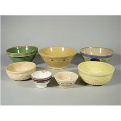 A collection of seven earthenware mixing bowls.