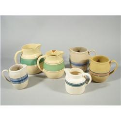 A group of six Stoneware jugs.