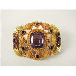 A gold and amethyst brooch,