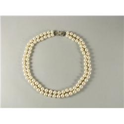 A double strand cultured pearl necklace.