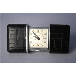 A Movado 20th Century steel cased travel clock,