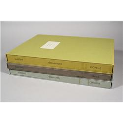"A group of three ""Derriere le Miroir"" books,"